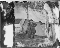 Brady-Civil-War-Photograph-Lt.-Gen.-Ulysses-S.-Grant-standing-by-a-tree-in-front-of-a-tent,-Cold-Harbor,VA.,-ca.-June-1864image-t